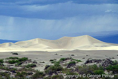 Storm Clouds Over Mojave Dunes